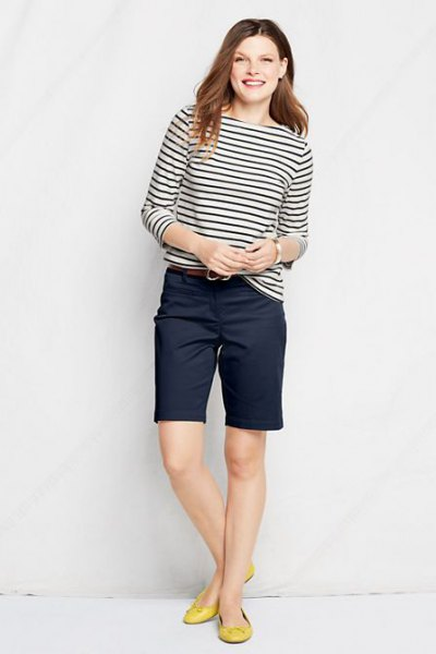 black and white striped long-sleeved T-shirt with knee-length chino shorts in navy blue