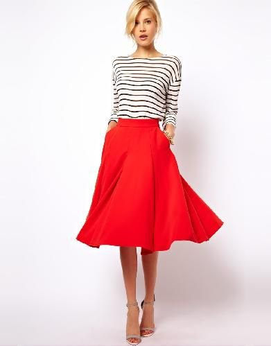 black and white striped long-sleeved T-shirt with red midi skirt