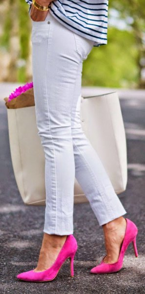 black and white striped long-sleeved T-shirt with slim fit jeans and pink heels