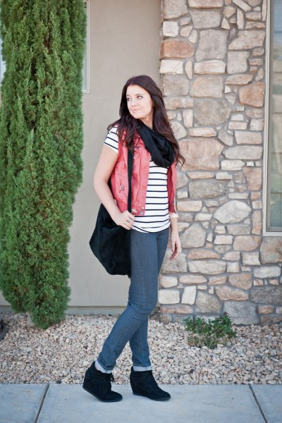 black-and-white striped short-sleeved T-shirt with beige vest and wedge boots