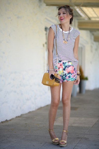 sleeveless black and white striped tank top with mini shorts with a floral pattern