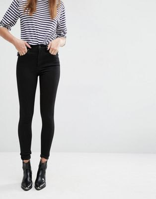 black and white striped t-shirt with high-waisted skinny jeans