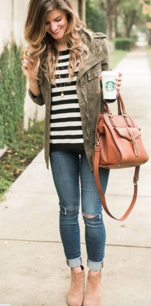 black and white striped t-shirt with military jacket and jeans