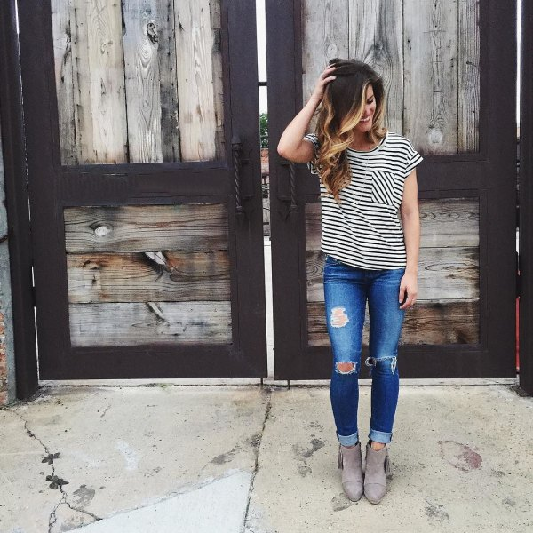 black and white striped t-shirt with ripped skinny jeans and suede boots