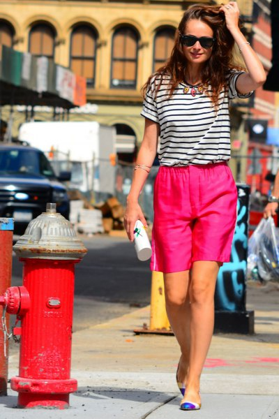 black and white striped t-shirt with shocking pink shorts with relaxed fit