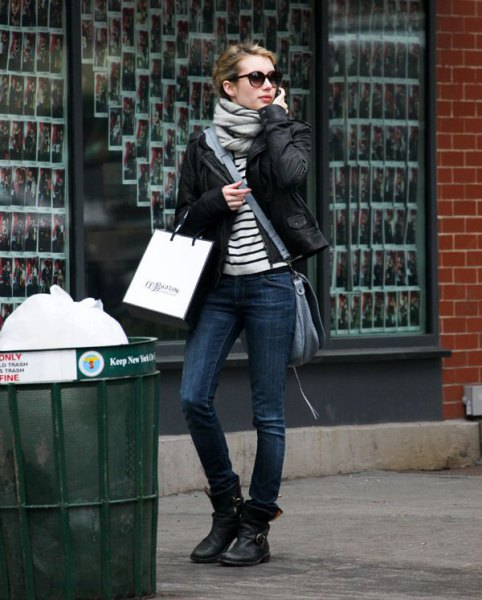 black and white striped t-shirt with biker jacket and leather motorcycle ankle boots