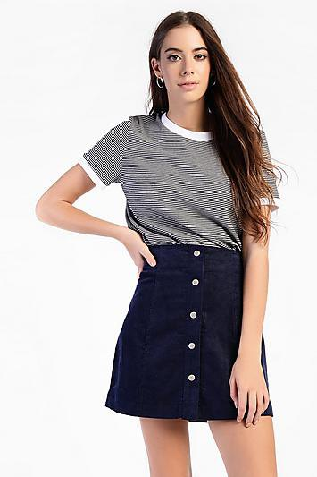 black and white striped t-shirt with a high-waisted corduroy skirt