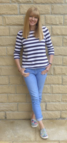 black and white striped t-shirt with light blue jeans with cuffs