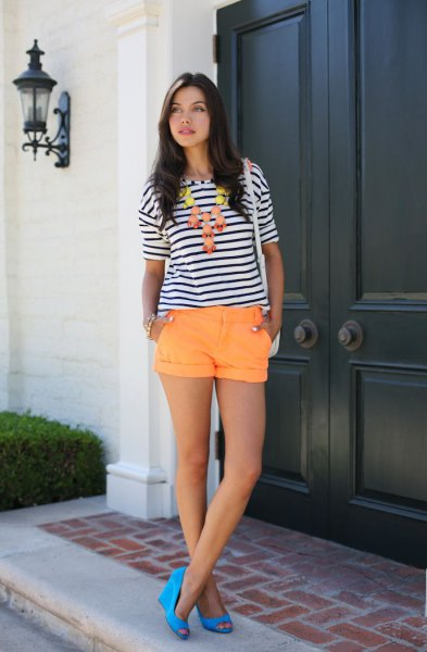 black and white striped t-shirt with orange shorts with cuffs
