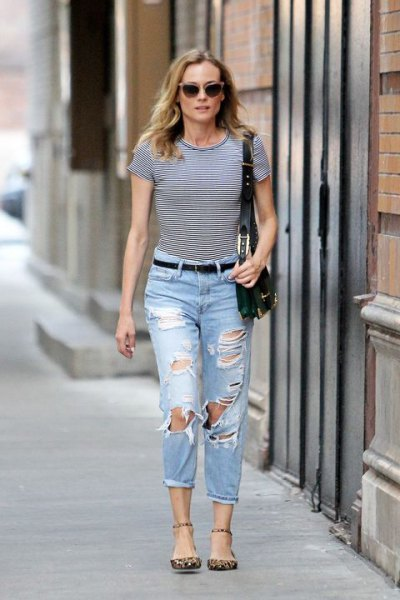 black and white striped t-shirt with ripped light blue jeans with cuffs