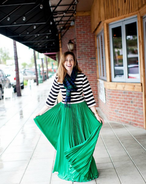 black and white striped three-quarter T-shirt with a green pleated maxi skirt