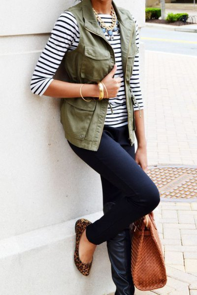 black and white striped three-quarter T-shirt with vest and dark jeans