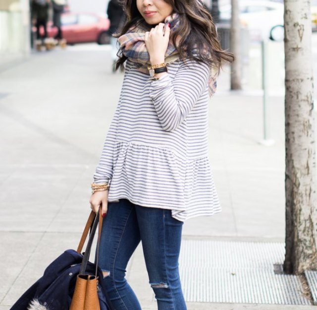 black and white striped top with red and gray checked wool scarf