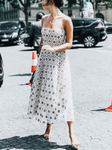 Black and white maxi dress with tribal print and lace-up sandals