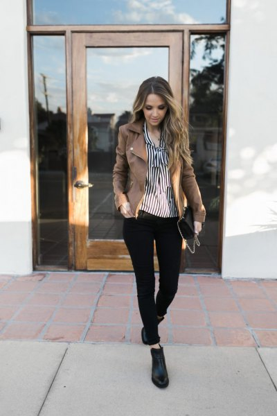 black and white vertical striped shirt with buttons and gray jeans blazer