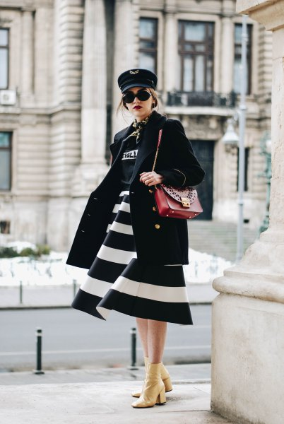 black and white wide striped midi dress with brown leather shoulder bag
