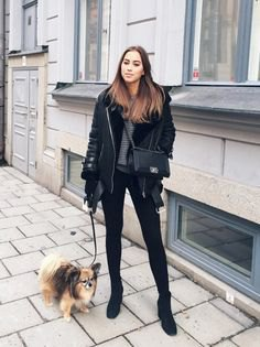 black aviator jacket with gray knitted sweater and skinny jeans