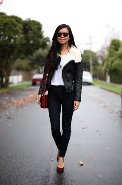 black aviator jacket with white fur collar and skinny jeans
