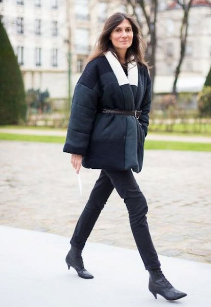 black coat with belt and short boots with kitten heel made of leather