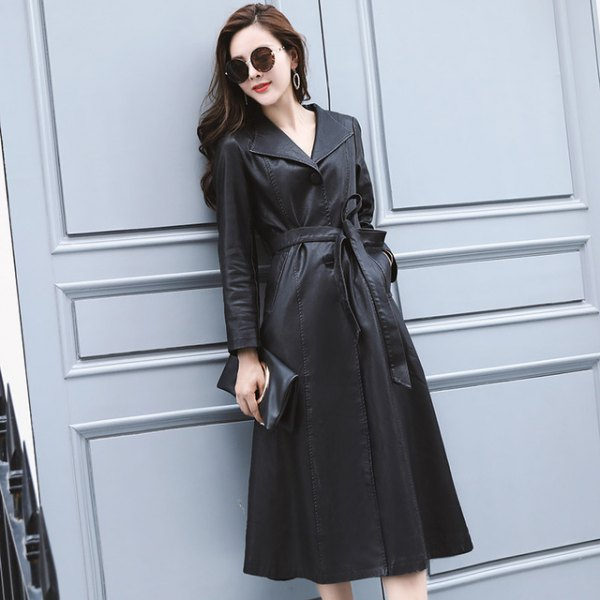 black trench coat dress with belt and ankle boots