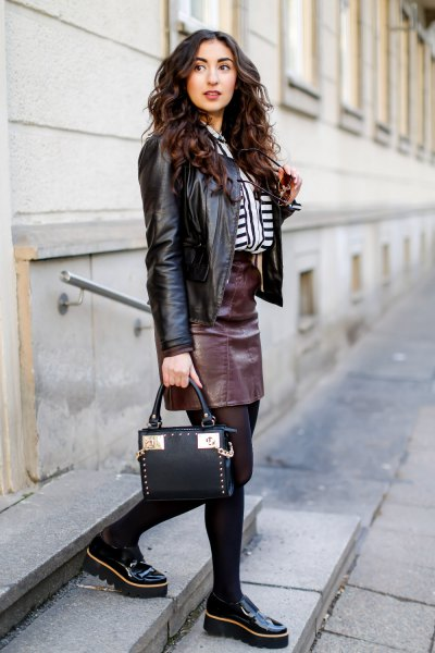 black biker jacket with leather skirt and slippers