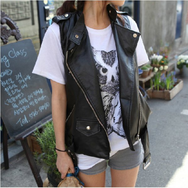black biker vest with white printed t-shirt and gray mini-shorts