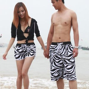 black bikini top with wide shorts with cardigan and zebra print