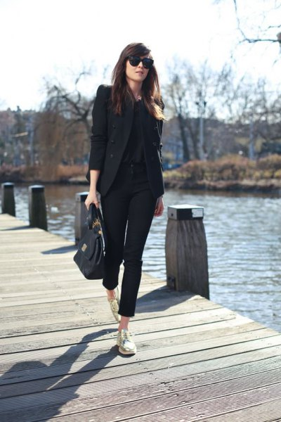 black blazer with cropped chinos and gold low-top sneakers