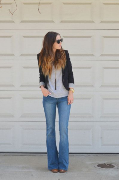 black blazer with gray t-shirt and blue flare jeans