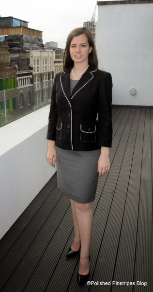 black blazer with gray top and matching pencil skirt