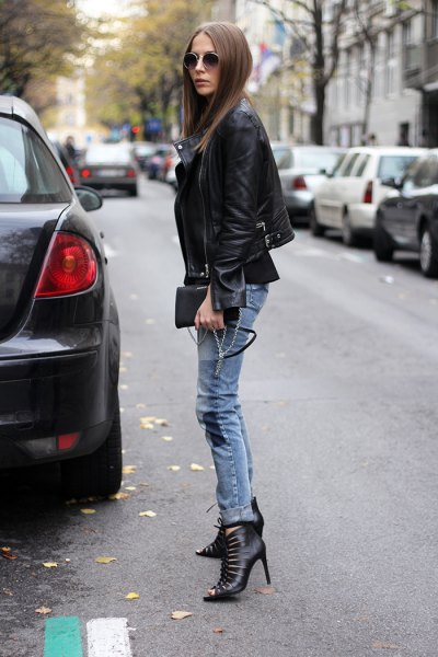 black blazer with gray-blue tube boots with tube neckline