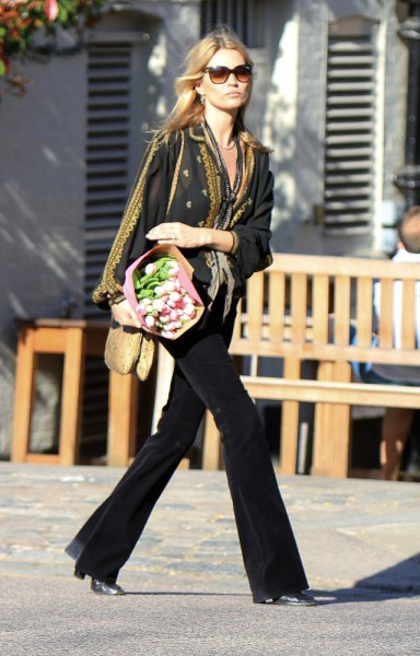 black blazer with scarf with leopard print and flared jeans