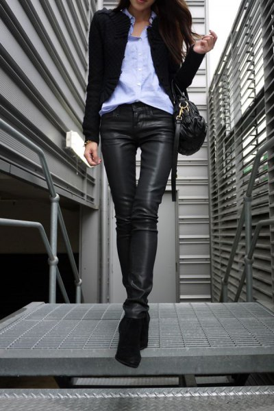 black blazer with light blue shirt with buttons and leather-covered jeans