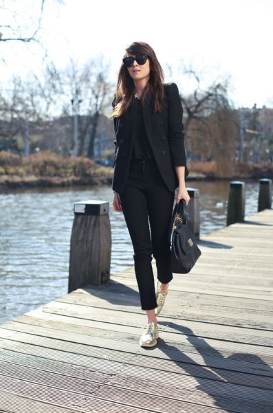 black blazer with matching blouse and cuffed jeans