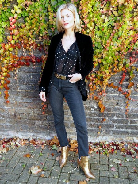 black blazer with a polka dot blouse and gold boots