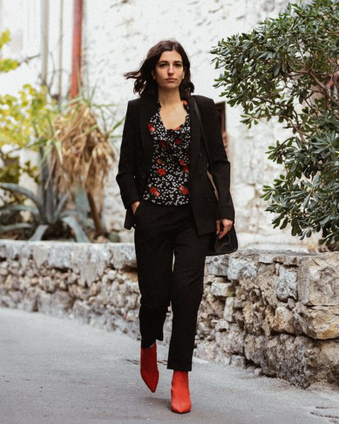 black blazer with printed top with scoop neckline and brown ankle on the boot