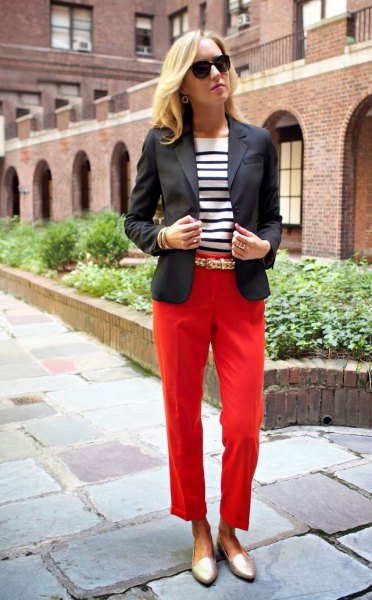 black blazer with red, cropped trousers and gold slippers