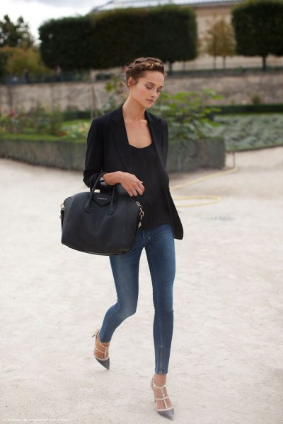 black blazer with narrow gray-blue jeans and pointed toe heels