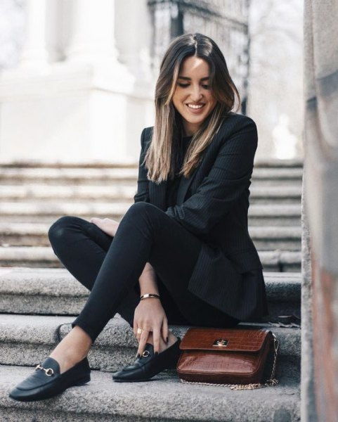 black blazer with slim fit jeans and tassel leather slippers