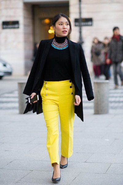 black blazer with statement chain and yellow chinos with straight legs