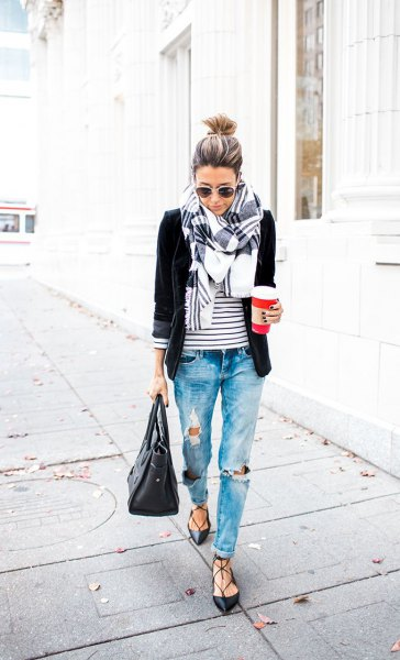 black blazer with a striped T-shirt and badly torn boyfriend jeans