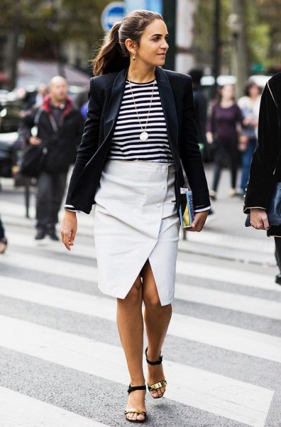 black blazer with striped T-shirt and white midi envelope skirt