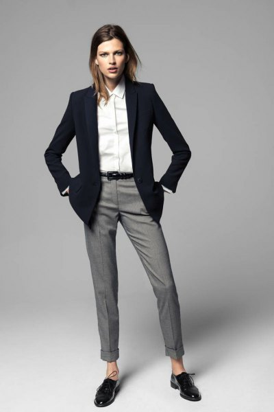 black blazer with white shirt with buttons and gray suit trousers with cuffs