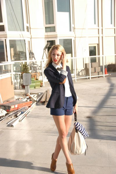 black blazer with white shirt with collar and dark blue shorts