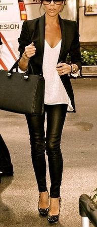 black blazer with white, low-cut tank top and leggings