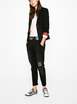 black blazer with white pleated blouse and cuffed jeans