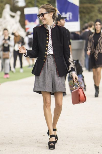 black blazer with white polka dot blouse and gray tweed shorts