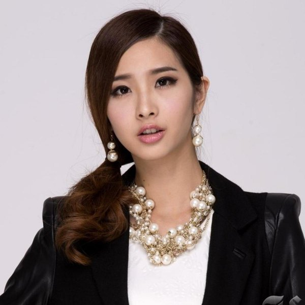 black blazer with white t-shirt with scoop neckline and gold chain