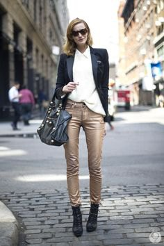 black blazer with white shirt and narrow golden trousers