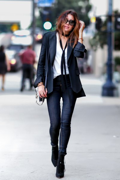 black blazer with white shirt and thin scarf